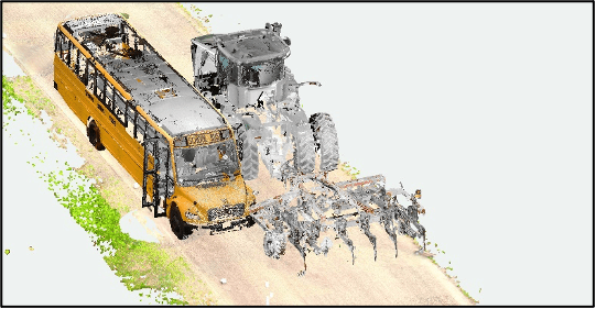 Mock up of bus and tractor before collision