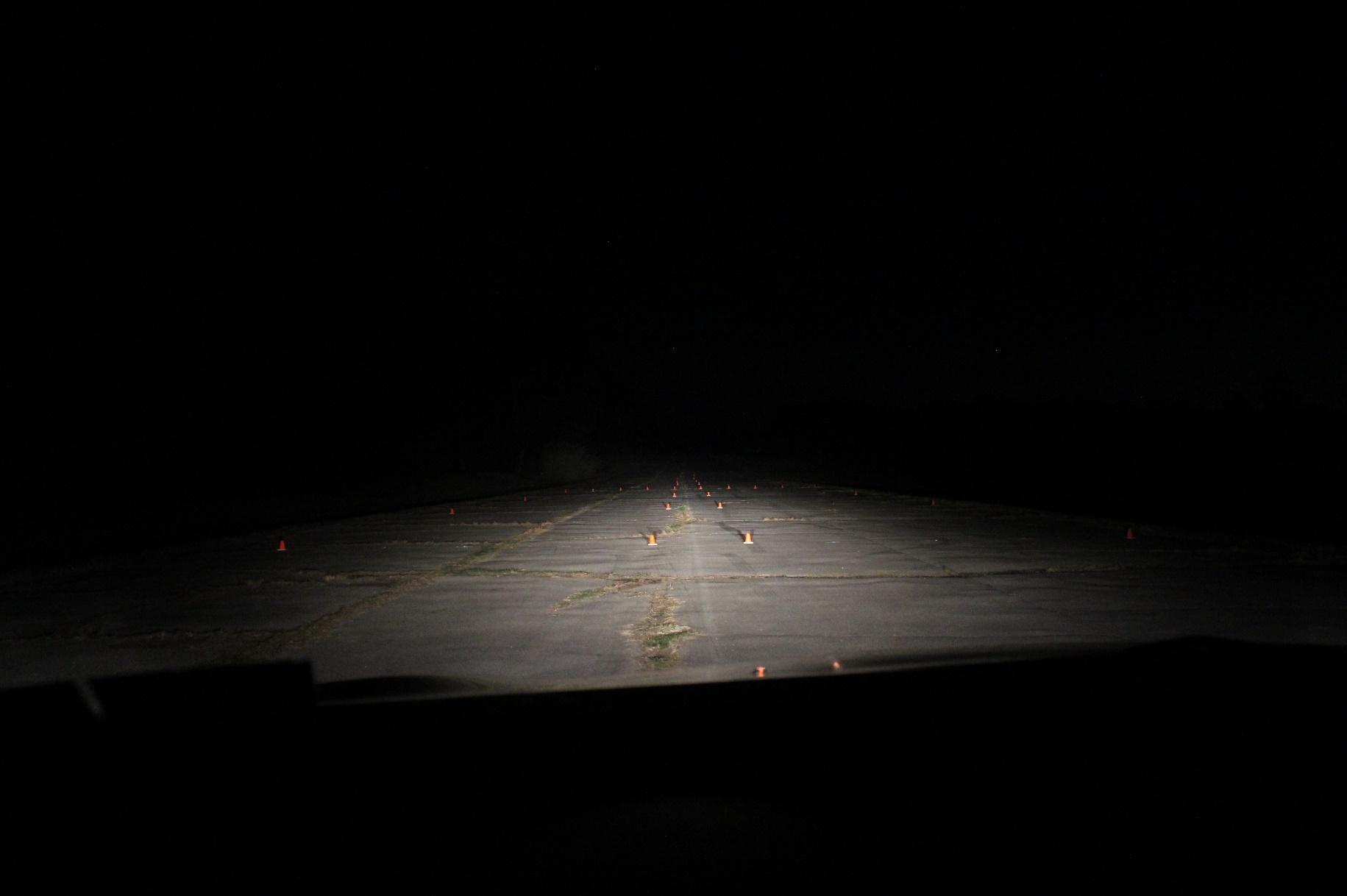 headlights illuminating the road at night